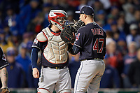 Cleveland Indians pitcher Trevor Bauer (47) talks with catcher Roberto Perez (55) in the fourth inning during Game 5 of the Major League Baseball World Series against the Chicago Cubs on October 30, 2016 at Wrigley Field in Chicago, Illinois.  (Mike Janes/Four Seam Images)