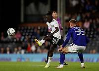 21st September 2021; Craven Cottage, Fulham, London, England; EFL Cup Football Fulham versus Leeds; Domingos Quina of Fulham crossing the ball past Charlie Cresswell of Leeds United