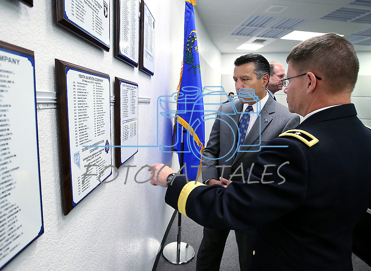 Gen. Mike Hanifan and Gov. Brian Sandoval talk following a Nevada National Guard Combat Veterans Remembrance Day ceremony at the Office of the Adjutant General in Carson City, Nev., on Friday, April 17, 2015. A tribute wall with the names of about 2,700 Nevada National Guard Soldiers and Airmen deployed into combat zones since Sept. 11, 2001 was unveiled. <br /> Photo by Cathleen Allison