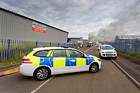 Pictured: Police at the scene. Monday 21 June 2021<br /> Re: Fire at a unit at Players Industrial Estate in the Clydach area of Swansea, Wales, UK.