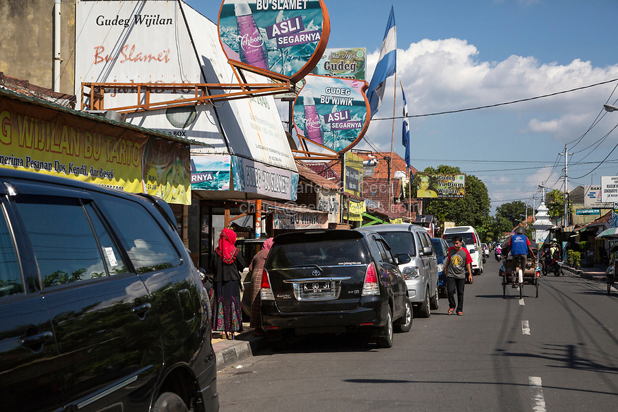 Yogyakarta, Java, Indonesia.  Street Scene, with Becak (Three-wheeled Rickshaw) Ahead.