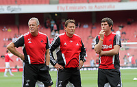 Pictured L-R: Swansea coaching staff Alan Curtis, Colin Pascoe, who is covering for Brendan Rodgers. Saturday 10 September 2011<br /> Re: Premiership Arsenal v Swansea City FC at the Emirates Stadium, London.
