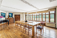 BNPS.co.uk (01202 558833)<br /> Pic: Hamptons/BNPS<br /> <br /> Pictured: A dining room with a view of the garden.<br /> <br /> An incredible Arts and Crafts country house with its own vineyard is on the market for offers over £7m.<br /> <br /> The Grade II listed St Joseph's Hall is a striking 111-year-old property that was home to the Bishop of Arundel for 40 years.<br /> <br /> It has a wealth of period features, an indoor swimming pool and seven acres of vineyard with mostly Chardonnay grapes, which the owners sell to a local winery.<br /> <br /> The house in Storrington, West Sussex, has 17 acres of land with beautiful views over the South Downs.