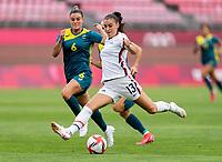 KASHIMA, JAPAN - JULY 27: Chloe Logarzo #6 of Australia defends Alex Morgan #13 of the USWNT during a game between Australia and USWNT at Ibaraki Kashima Stadium on July 27, 2021 in Kashima, Japan.