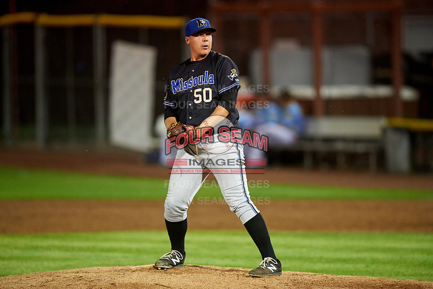 Missoula Osprey relief pitcher Landon Whitson (50) prepares to deliver a pitch during a Pioneer League game against the Idaho Falls Chukars at Melaleuca Field on August 20, 2019 in Idaho Falls, Idaho. Idaho Falls defeated Missoula 6-3. (Zachary Lucy/Four Seam Images)