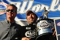 Nov. 13, 2011; Pomona, CA, USA; NHRA president Tom Compton (left) with top fuel dragster driver Del Worsham after clinching the 2011 world championship at the Auto Club Finals at Auto Club Raceway at Pomona. Mandatory Credit: Mark J. Rebilas-.