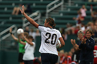 USWNT's Abby Wambach (20) waves to the crowd after scoring her 100th career goal in the second half. The U.S. Women's National Team defeated Canada 1-0 in a friendly match at Marina Auto Stadium in Rochester, NY on July 19, 2009.