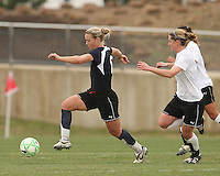 Lori Lindsey (blue) of the Washington Freedom moves away from Jen Buczkowski  of Sky Blue F.C. during a WPS pre season match at Maryland Soccerplex, in Boyd's, Maryland on March 14 2009. Sky Blue won the match 1-0