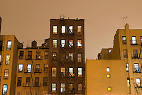 Lower East Side Tenement Apartment Buildings Illuminated at Night, New York City, New York State, USA.<br />