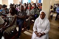 BURKINA FASO , Gaoua, mass in catholic church / Messe in der katholischen Kirche, Sr. NATALIE DENA