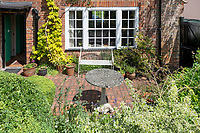 BNPS.co.uk (01202) 558833.<br /> Pic: CarterJonas/BNPS<br /> <br /> Pictured: Garden patio. <br /> <br /> The former family home of Lord of the Flies author William Golding has gone on sale for £1m.<br /> <br /> The Grade II Listed cottage on a green in Marlborough is said to have inspired some of the Nobel Prize winning writer's work.<br /> <br /> His parents Alec, a teacher, and Mildred, a suffragette, bought the house and moved there in 1905, when Mr Golding obtained a job at the town's grammar school.<br /> <br /> Sir William was born in 1911 and he and his brother lived in the property and its location influenced his writing. He wrote of the property: 'Our house was on the green, that close like square, tilted south'.