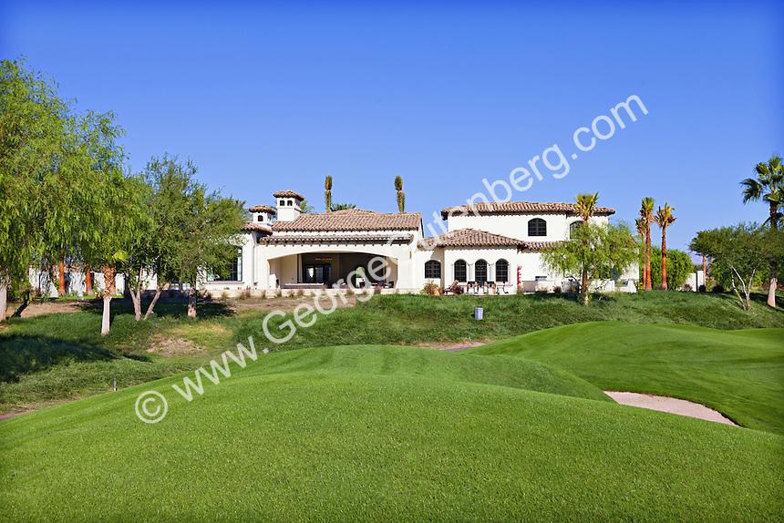 Large Mediterranean-style home overlooks undulating golf course