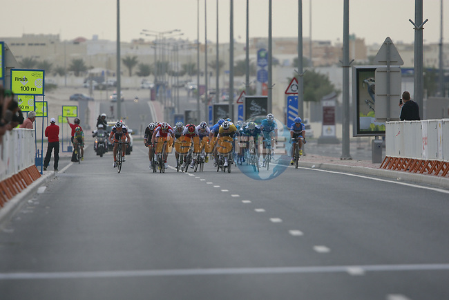 The sprinters approach the finish line at the end of Stage 3 of the 2012 Tour of Qatar running 146.5km from Dukhan Souq, Dukhan to Al Gharafa, Qatar. 7th February 2012.<br /> (Photo Eoin Clarke/Newsfile)