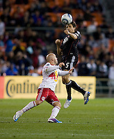 Dejan Jakovic (5) of D.C. United heads the ball away from Luke Rodgers (9) of the New York Red Bulls during the game at RFK Stadium in Washington, DC.  D.C. United lost to the New York Red Bulls, 4-0.