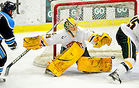 29 January 2010: University of Vermont Catamount goaltender Rob Madore, a Sophomore from Venetia, PA, gives up a third period goal to the University of Maine Black Bears at Gutterson Fieldhouse in Burlington, Vermont. The Black Bears defeated the Catamounts 6-3 in the first game of their America East weekend series. Mandatory Credit: Ed Wolfstein Photo