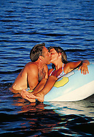 couple in bathing suits kissing in lake. couple.