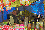 A local man running a  temporary restaurant  near the Bijli Mahadev Temple in the mountains above Kullu in the Kullu Valley, Himachal Pradesh, India.