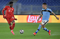 Alphonso Davies of FC Bayern Munchen and Sergej Milinkovic-Savic of SS Lazio during the Champions League round of 16 football match between SS Lazio and Bayern Munchen at stadio Olimpico in Rome (Italy), February, 23th, 2021. Photo Andrea Staccioli / Insidefoto