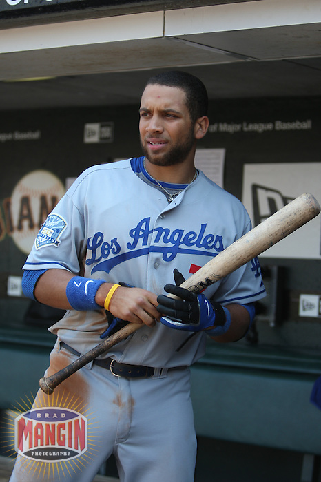 SAN FRANCISCO - JULY 6:  James Loney of the Los Angeles Dodgers gets ready to bat in the dugout during the game against the San Francisco Giants at AT&T Park in San Francisco, California on July 6, 2008.  The Dodgers defeated the Giants 5-3.  Photo by Brad Mangin