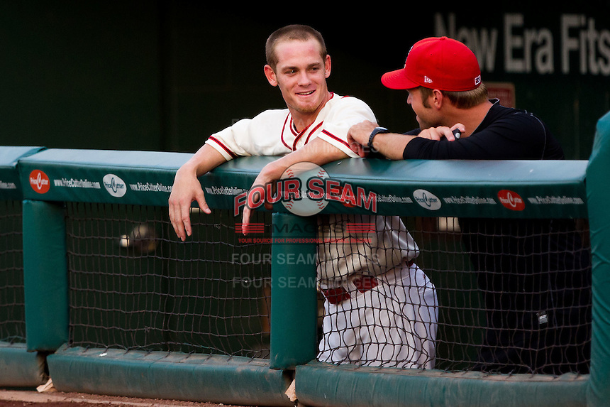 Ryan Jackson (23) of the Springfield Cardinals talks with a teammate during a game against the Northwest Arkansas Naturals and the Springfield Cardinals at Hammons Field on July 30, 2011 in Springfield, Missouri. Springfield defeated Northwest Arkansas 11-5. (David Welker / Four Seam Images)