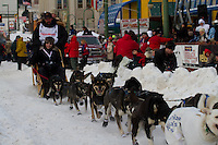 2010 Iditarod Ceremonial Start in Anchorage Alaska musher # 24 ART CHURCH  with Iditarider AARON CRAFT