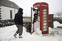 03/03/18<br /> <br /> Commission Fea0081816 Assigned<br /> <br /> Cold Call!<br /> <br /> A passer-by inspects a phone box after blizzards forced snow through a half broken window pane in Parsley Hay the Derbyshire Peak District.<br />   <br /> All Rights Reserved F Stop Press Ltd. +44 (0)1335 344240 +44 (0)7765 242650  www.fstoppress.com