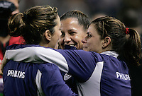 USWNT players Mia Hamm, Julie Foudy, and Joy Fawcett embrace after playing in their last soccer match at the Home Depot Center in Carson, Calif., Tuesday, Dec., 7, 2004.