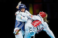 10 AUG 2012 - LONDON, GBR - Sousan Hajipourgoli (IRI) (left) of Iran tries to defend against a kick during her women's -67kg category preliminary round contest against Carmen Marton of Australia at the London 2012 Olympic Games Taekwondo at Excel in London, Great Britain (PHOTO (C) 2012 NIGEL FARROW)