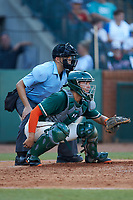 Greensboro Grasshoppers catcher Will Banfield (18) sets a target as home plate umpire Josh Gilreath looks on during the game against the West Virginia Power at First National Bank Field on August 9, 2018 in Greensboro, North Carolina. The Power defeated the Grasshoppers 5-3 in game one of a double-header. (Brian Westerholt/Four Seam Images)