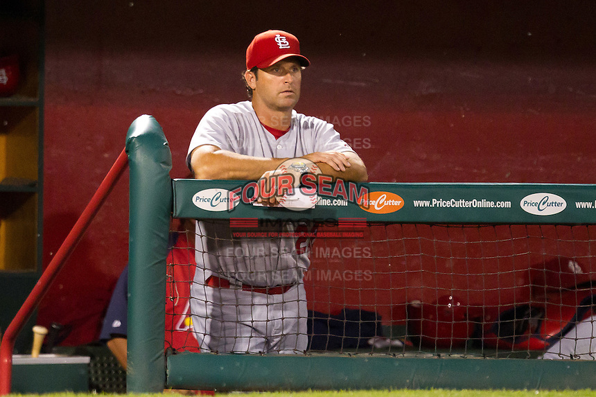 Manager Mike Matheny (22) of the St. Louis Cardinals stands in the dugout during a game against the Springfield Cardinals at Hammons Field on April 2, 2012 in Springfield, Missouri. (David Welker/Four Seam Images)