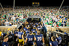 Sept. 5, 2015; The football team walks up the tunnel at Notre Dame Stadium after defeating Texas 38-3. (Photo by Matt Cashore)