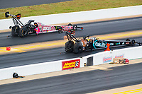 Oct 14, 2018; Concord, NC, USA; NHRA top fuel driver Dom Lagana (near) alongside Brittany Force during the Carolina Nationals at zMax Dragway. Mandatory Credit: Mark J. Rebilas-USA TODAY Sports
