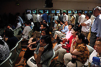 Chinese investors watch stock index in a stock exchange of Beijing. Chinese share prices broke through the psychologically important 4000-mark for the first time ever last week and dealers said the sustained Chinese advance is being driven by massive inflows of fresh funds as smaller investors take their money out of low-return bank deposits and punt on stocks..16 May 2007