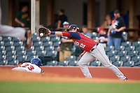Hagerstown Suns third baseman Grant DeBruin (12) stretches for a pickoff throw as Humberto Arteaga (23) dives back to the bag during a game against the Lexington Legends on May 22, 2015 at Whitaker Bank Ballpark in Lexington, Kentucky.  Lexington defeated Hagerstown 5-1.  (Mike Janes/Four Seam Images)