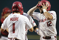 Arkansas catcher Casey Opitz (12) reacts following a home-run score, Monday, June 7, 2021 in the eighth inning of the NCAA Fayetteville Regional at Baum-Walker Stadium in Fayetteville. Check out nwaonline.com/210608Daily/ for today's photo gallery. <br /> (NWA Democrat-Gazette/Charlie Kaijo)