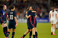 ORLANDO, FL - MARCH 05: Christen Press #23 of the United States scores a goal and celebrates with Tobin Heath #17 during a game between England and USWNT at Exploria Stadium on March 05, 2020 in Orlando, Florida.