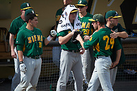 Siena Saints starting pitcher Chris Amorosi (24) fist bumps teammates after getting pulled during a game against the UCF Knights on February 21, 2016 at Jay Bergman Field in Orlando, Florida.  UCF defeated Siena 11-2.  (Mike Janes/Four Seam Images)