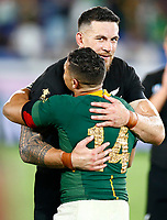 Sonny Bill Williams of New Zealand (All Blacks) hugs Cheslin Kolbe of South Africa during the Rugby World Cup Pool B match between the New Zealand All Blacks and South Africa Springboks at the International Stadium in Yokohama, Japan on Saturday, 21 September, 2019. Photo: Steve Haag / stevehaagsports.com