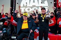 Oct 4, 2020; Madison, Illinois, USA; NHRA top fuel driver Doug Kalitta (right) and team owner Connie Kalitta celebrates after winning the Midwest Nationals at World Wide Technology Raceway. Mandatory Credit: Mark J. Rebilas-USA TODAY Sports