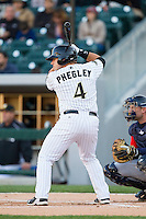 Josh Phegley (4) of the Charlotte Knights at bat against the Gwinnett Braves at BB&T Ballpark on April 16, 2014 in Charlotte, North Carolina.  The Braves defeated the Knights 7-2.  (Brian Westerholt/Four Seam Images)