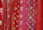 Flower Hmong Velvet - Red velvet fabric for sale at the Saturday market, Can Cau, NW Viet Nam