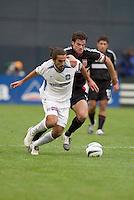 San Jose Earthquakes' Dwayne De Rosario is marked by D.C. United's Ryan Nelsen. DC United defeated the San Jose Earthquakes 2 to 1 during the MLS season opener at RFK Stadium, Washington, DC, on April 3, 2004.