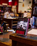 "July 26, 2017. Raleigh, North Carolina.<br /> <br /> Copies of ""Refugee"" were displayed at the check out of Quail Ridge Books. <br /> <br /> Author Alan Gratz spoke about and signed his new book ""Refugee"" at Quail Ridge Books. The young adult fiction novel contrasts the stories of three refugees from different time periods, a Jewish boy in 1930's Germany , a Cuban girl in 1994 and a Syrian boy in 2015."