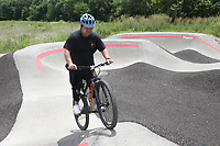 """David Hang of Springfield, Mo. rides, Sunday, July 18, 2021 at the Thaden School pump track in Bentonville. He is visiting the trails in Northwest Arkansas for the first time from the recommendation of friends and Youtube riders. He saw an opportunity to develop a new hobby during the covid-19 shutdown after taking a long hiatus from BMX riding. """"Hopefully they grow to what NWA is,"""" he said of his hometown's riding scene. Over the weekend he was able to hit the Railyard, Slaughter Pen and the trails at Bella Vista he said. """"You stay downtown and get an Airbnb, and you don't have to drive anywhere to hit the trails,"""" he said for why he likes the riding scene here. Check out nwaonline.com/210719Daily/ for today's photo gallery. <br /> (NWA Democrat-Gazette/Charlie Kaijo)"""