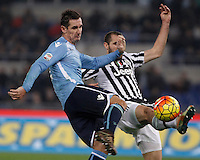 Calcio, Serie A: Lazio vs Juventus. Roma, stadio Olimpico, 4 dicembre 2015.<br /> Lazio's Miroslav Klose, left, is challenged by Juventus' Giorgio Chiellini during the Italian Serie A football match between Lazio and Juventus at Rome's Olympic stadium, 4 December 2015.<br /> UPDATE IMAGES PRESS/Isabella Bonotto