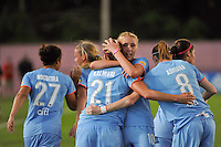Laura Kalmari (21) of Sky Blue FC celebrates scoring with teammates including Allie Long (10). Sky Blue FC defeated the Atlanta Beat 3-0 during a Women's Professional Soccer (WPS) match at Yurcak Field in Piscataway, NJ, on May 21, 2011.