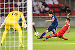 Ito Junya of Japan (L) attempts to score during the AFC Asian Cup UAE 2019 Group F match between Oman (OMA) and Japan (JPN) at Zayed Sports City Stadium on 13 January 2019 in Abu Dhabi, United Arab Emirates. Photo by Marcio Rodrigo Machado / Power Sport Images