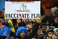 "17th July 2021; Hamilton, New Zealand;  ""Vaccinate Fiji"" signs held up by fans. All Blacks versus Fiji, Steinlager Series, international rugby union test match. FMG Stadium Waikato, Hamilton, New Zealand."