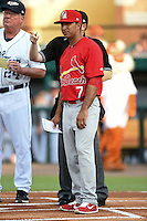 Palm Beach Cardinals manager Oliver Marmol (7) listens to umpire Ryan Doherty (hidden) explain ground rules before a game against the Lakeland Flying Tigers on April 13, 2015 at Joker Marchant Stadium in Lakeland, Florida.  Palm Beach defeated Lakeland 4-0.  (Mike Janes/Four Seam Images)