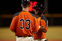 AZL Giants Orange catcher Rodolfo Bone (5) and coach Bill Horton (33) during a game against the AZL Angels at Giants Baseball Complex on June 17, 2019 in Scottsdale, Arizona. AZL Giants Orange defeated AZL Angels 8-4. (Zachary Lucy/Four Seam Images)